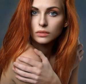 Woman with Beautiful Skin Demonstrating One of the Health Benefits of Oranges