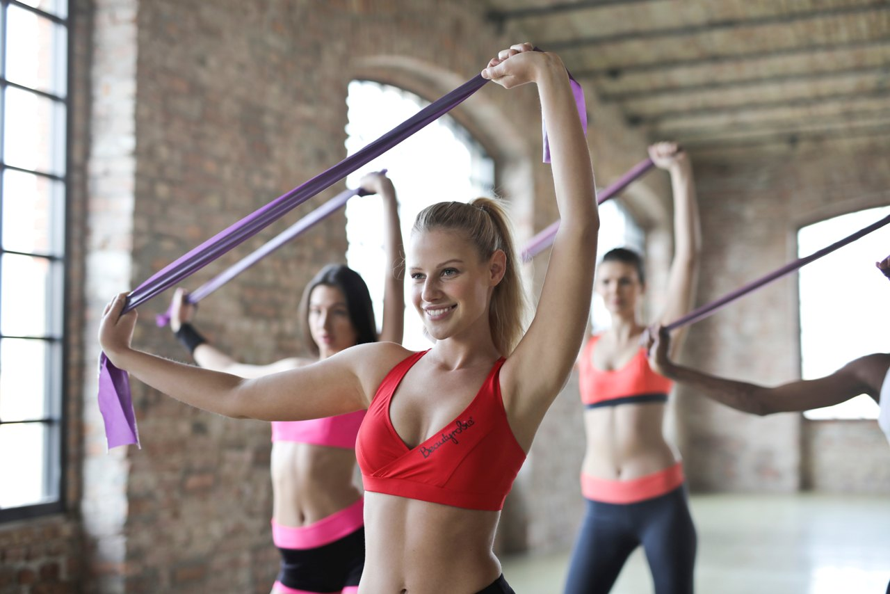 Girls Using Resistance Bands