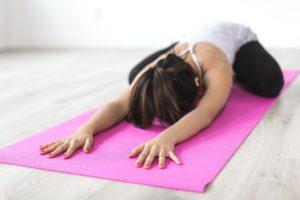 Woman Doing Pilates on a Mat
