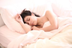 Woman Sleeping in the Bedroom Demonstrating that Fitness is Important for Good Sleep