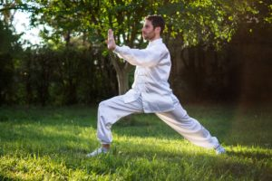Man Performing Tai Chi for Flexibility, One of The Components of Physical Fitness